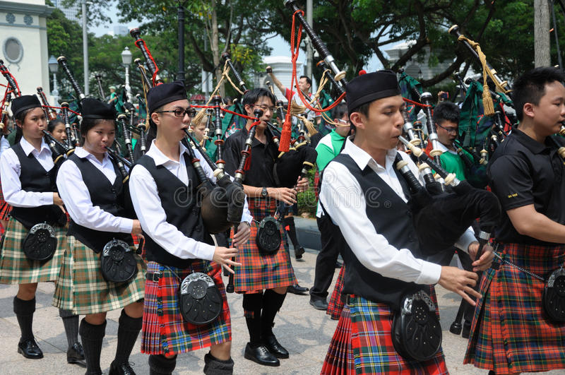 Saint Patrick`s Day Bagpipe Music Band. On parade. Event in Singapore on 19th March 2017 Sunday along the Singapore River stock photography