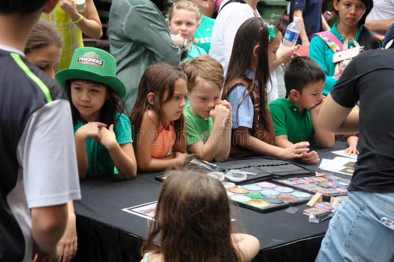 Saint Patrick`s Day face painting booth stock images