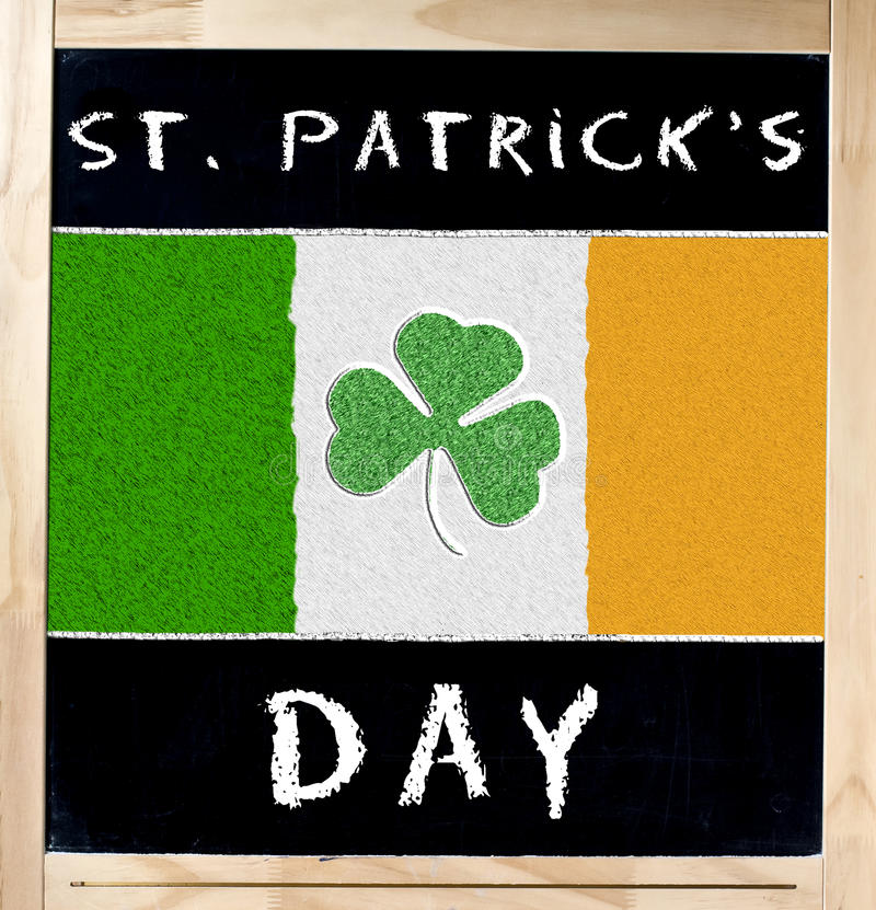 Saint Patrick s Day and Irish Flag on Blackboard. St. Patricks or Saint Patrick s Day handwritten with white chalk and flag of Ireland with shamrock on stock images