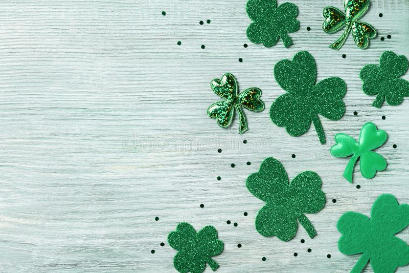 Saint Patricks Day background with green shamrock on white rustic board top view. Saint Patricks Day background with green shamrock on rustic board top view stock photo