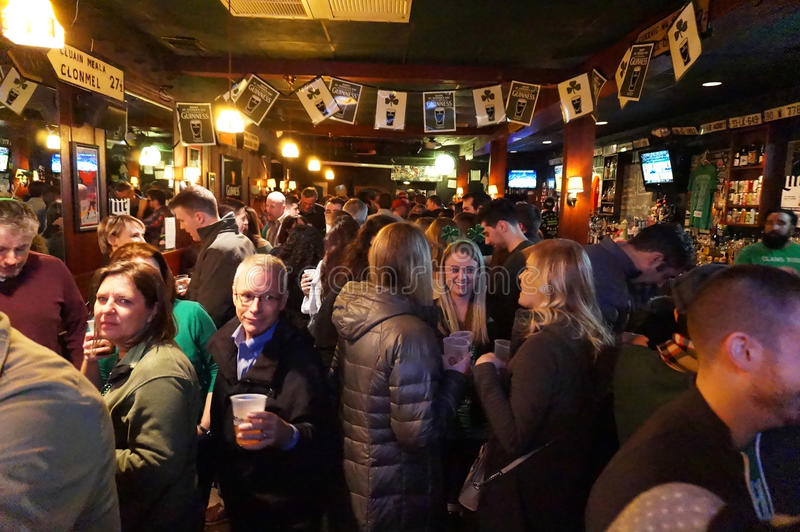 Saint Patricks Day at the Pub. Photo of people socializing and drinking inside an irish pub called nanny obriens on saint patricks day on 3/17/17 at night. There royalty free stock photo