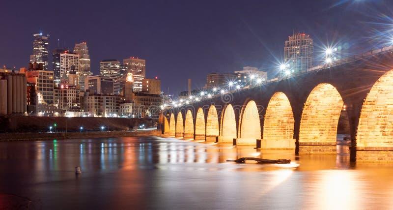 Saint Paul Minnesota Capital City Skyline Mississippi River Rams. The Stone Arch Bridge dominates the night scene in Saint Paul Minnesota royalty free stock photography