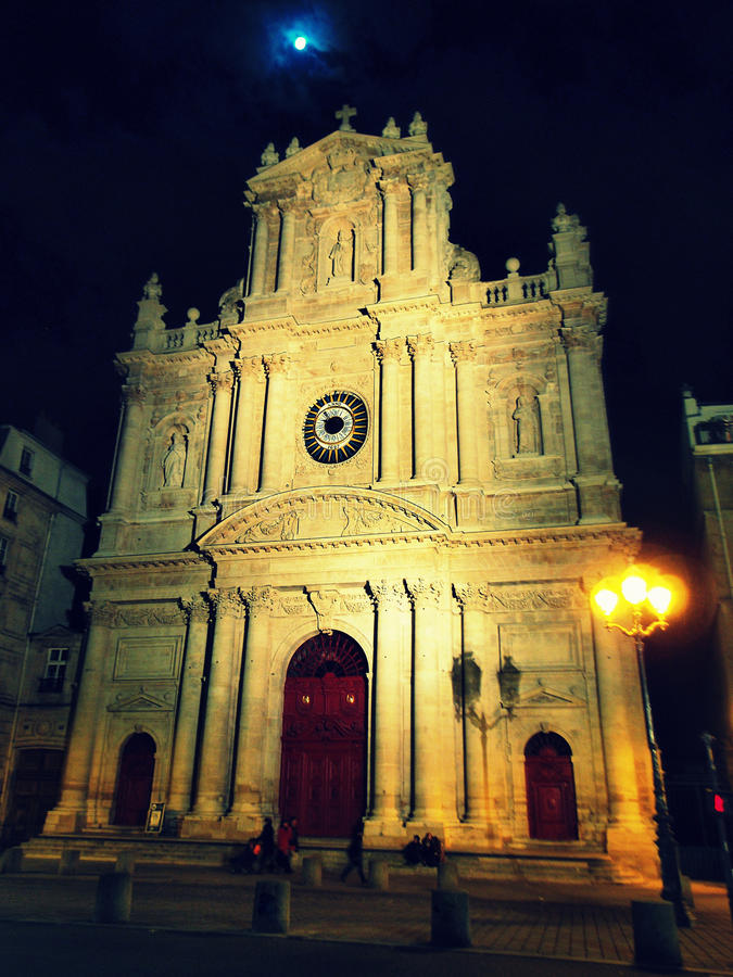 Saint Paul - Saint Louis church at night, Paris. Holy night in Paris - Beautiful church standing and guiding people through the city at night, with moon in the stock photo