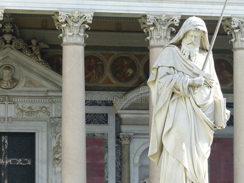 Saint Paul statue in front of the basilica of Saint Paul outside the walls in Rome, Italy. royalty free stock photo