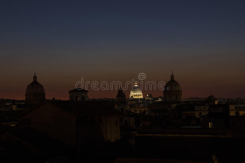 St. Peter dome shines at sunset, in Rome, Italy royalty free stock images
