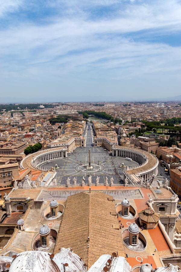 Saint Peter`s Square in Vatican and aerial view of Rome. Italy royalty free stock image