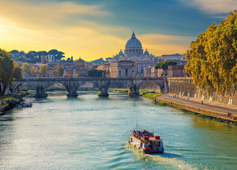 Saint Peters basilica view, Roma, Italy. Touristic boat sailing on Tiber river at evening, with Saint Peters basilica on the background. Roma. Italy royalty free stock photos