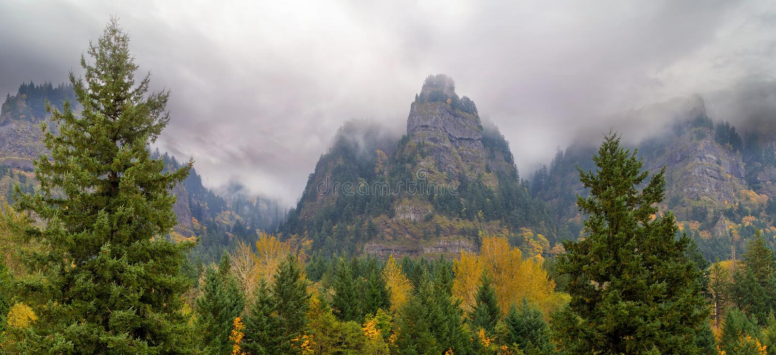 Saint Peters Dome at Columbia River Gorge fall season. St Peters Dome along Columbia River Gorge on a foggy day in fall season panorama stock photography