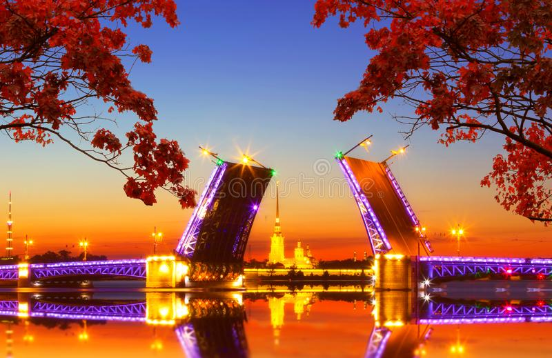 Saint Petersburg at autumn sunset. Saint Petersburg at sunset, framed by autumn leaves. Vintage colored picture. Business, Love and travel concept stock photography
