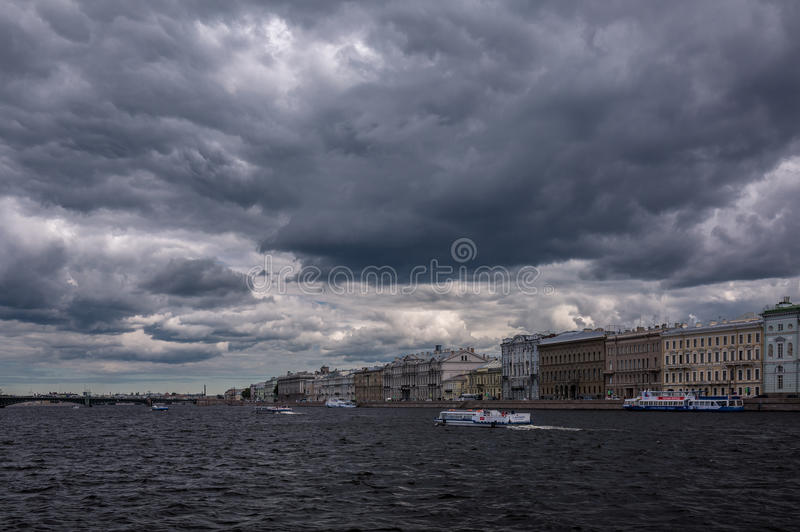Saint - Petersburg clouds above Neva river in summer stock photo