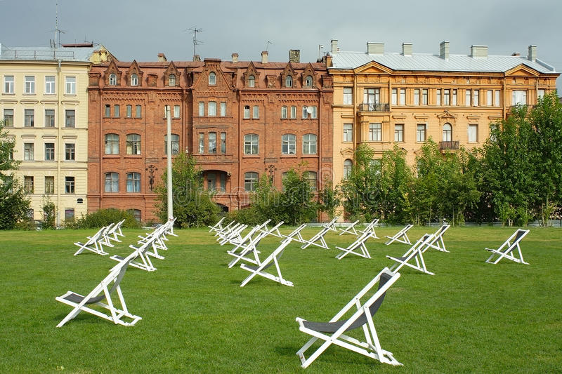 Saint-Petersburg, lawn with sun loungers. Saint-Petersburg, green lawn with sun loungers on the New Holland island royalty free stock images
