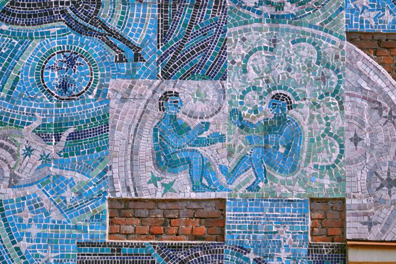 Saint Petersburg, Russia - August 23, 2018: A fragment of a mosaic on the theme Man and space on the wall of the house on Botkin s. Treet, 1. Zodiac sign Twins royalty free stock image