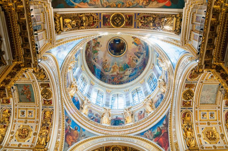 Saint Petersburg, Russia. Highly ornated ceiling with windows of the central dome of St Isaac Cathedral. Saint Petersburg, Russia -August 15, 2017. Highly royalty free stock photos