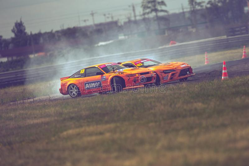 Saint-Petersburg, Russia - August 15, 2018: Powerful race car drifting on speed track stock photos
