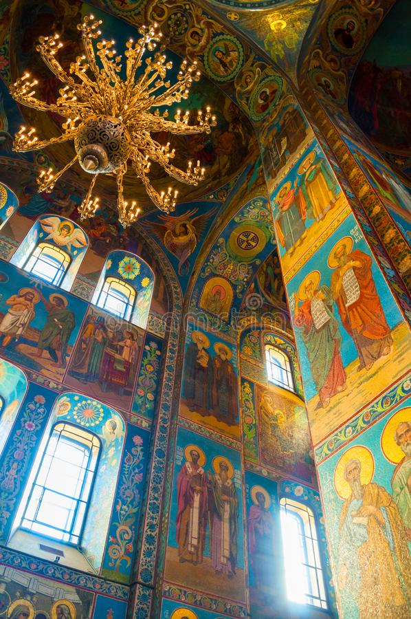 Saint Petersburg, Russia. Cathedral of Our Savior on Spilled blood - inside view. Mosaics and chandelier stock photography