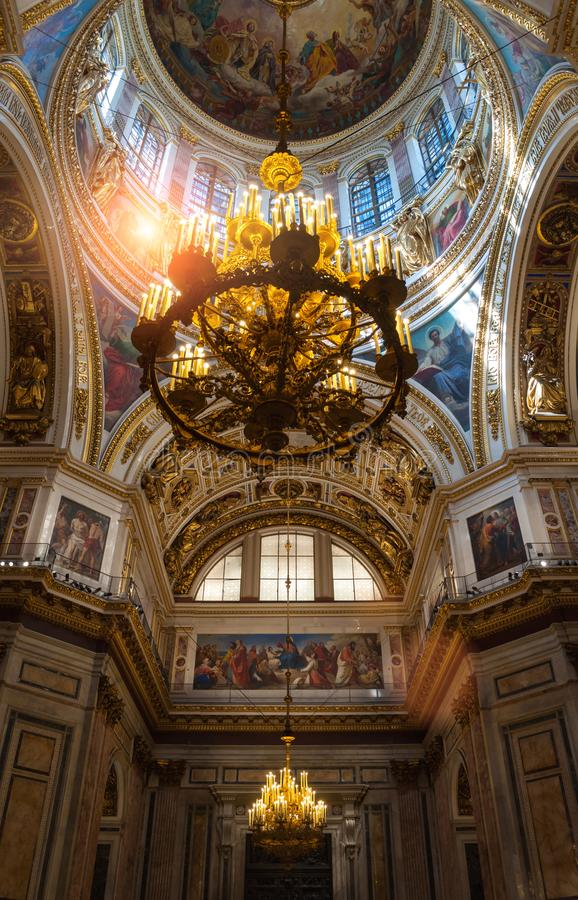 Saint Petersburg, Russia. Ceiling with windows and chandelier under the central dome of Saint Isaac Cathedral. Saint Petersburg, Russia -August 15, 2017. Ceiling stock photos