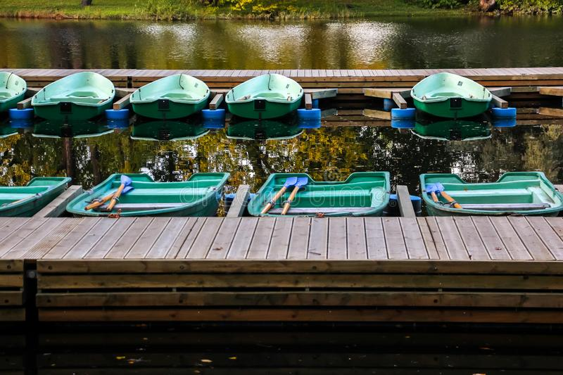 Beautiful autumn, boats moored at the rental station royalty free stock image