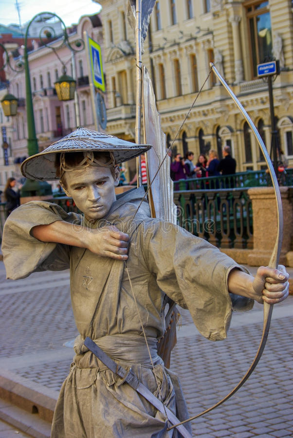 Saint Petersburg, Russia - JAN. 01, 2008: performer - Silver painted artists on a city street, living stat stock photos