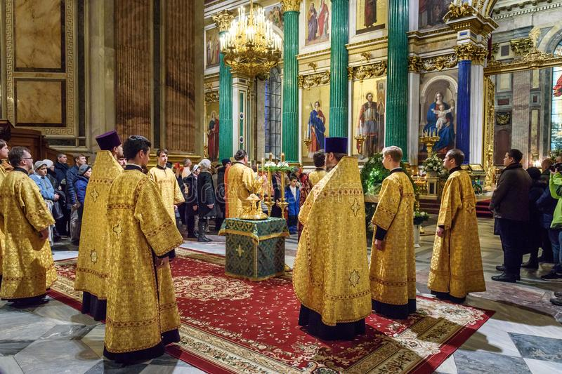 Christmas service at Saint Isaac`s Cathedral or Isaakievskiy Sobor in Saint Petersburg. Russia. Saint Petersburg, Russia - January 6, 2018: Christmas service at royalty free stock image