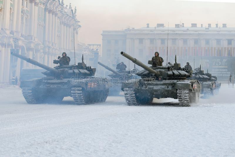 A column of T-72B3 tanks on Palace Square. SAINT-PETERSBURG, RUSSIA - JANUARY 24, 2019: A column of T-72B3 tanks on Palace Square. Dress rehearsal for the royalty free stock photos