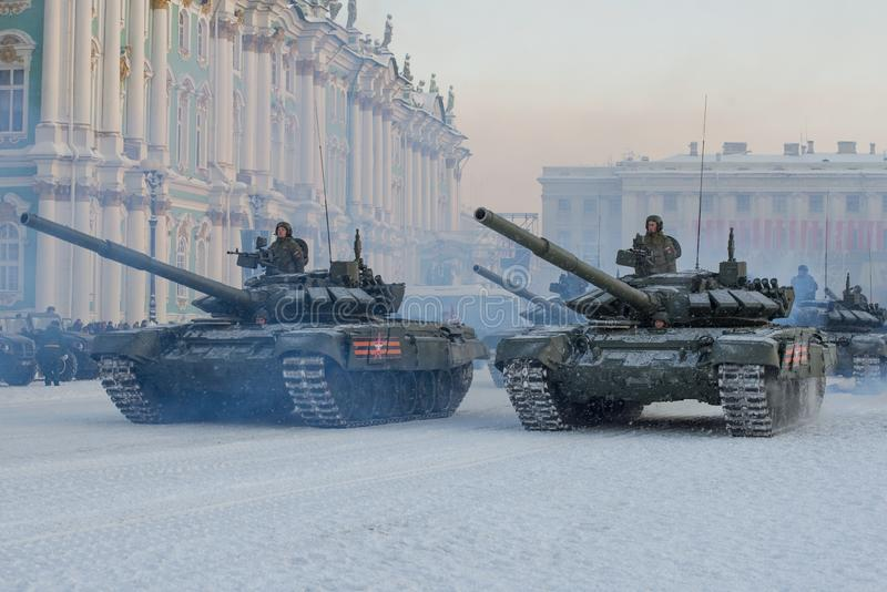 A column of T-72B3 tanks at the Winter Palace. SAINT-PETERSBURG, RUSSIA - JANUARY 24, 2019: A column of T-72B3 tanks at the Winter Palace. Fragment of a royalty free stock photos