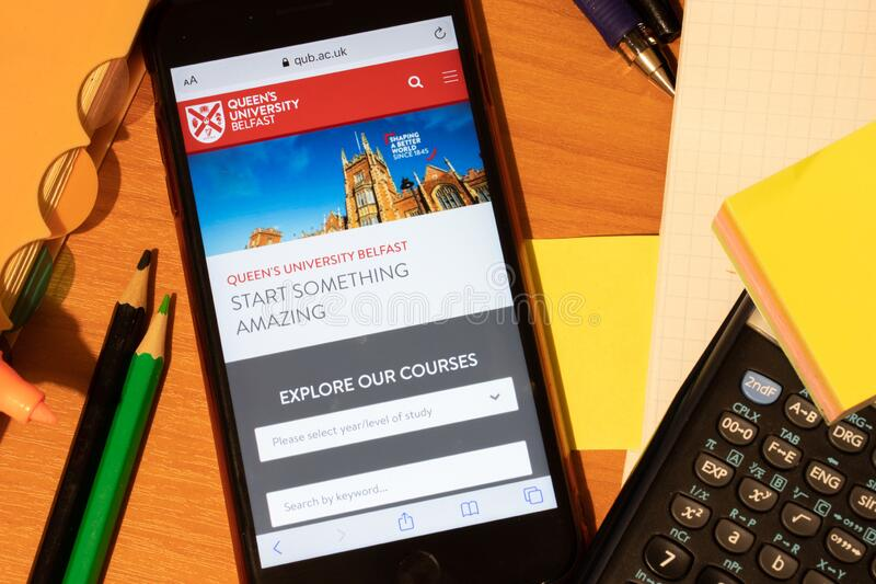 Saint-Petersburg, Russia - 10 January 2020: Phone screen with Queen`s University Belfast website page. Higher education admission royalty free stock photography