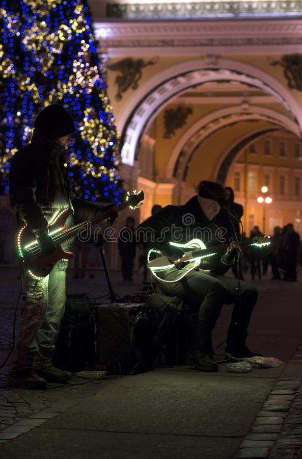 Street musicians with night illumination and Christmas tree royalty free stock images