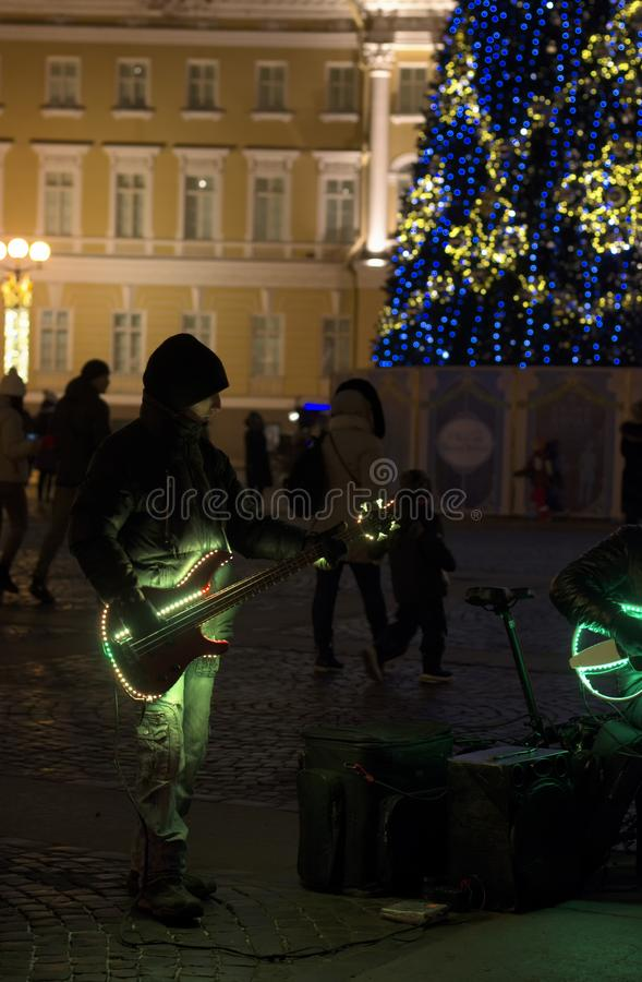 Street musicians with night illumination and Christmas tree stock images