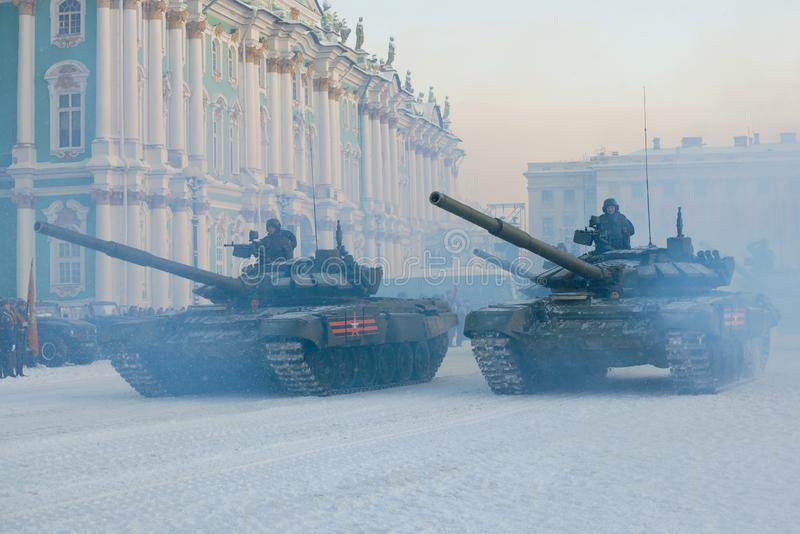 Two Russian tanks at the final rehearsal of the military parade. SAINT-PETERSBURG, RUSSIA - JANUARY 24, 2019: Two Russian tanks at the final rehearsal of the royalty free stock image