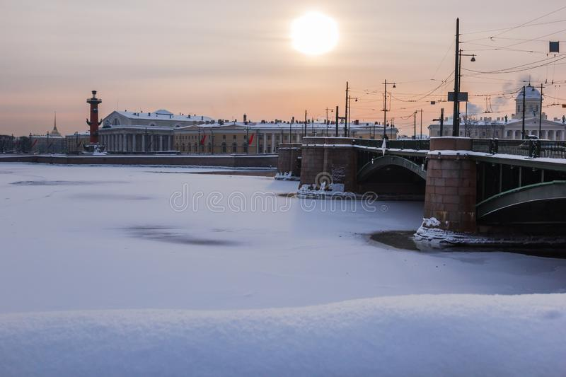 Saint Petersburg, Russia - January 27, 2019: Winter view of St. Petersburg, Russia, with the Palace Bridge, the Rostral royalty free stock image