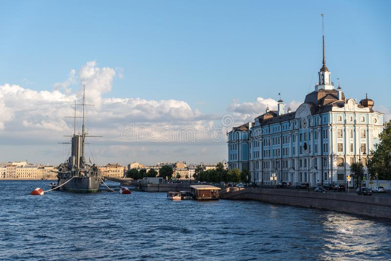Cruiser Aurora on Neva river and Nakhimov Naval School in St. Petersburg, Russia stock image