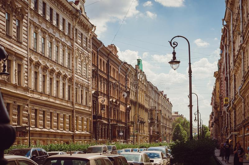 Narrow street with beautiful stained houses in St. Petersburg. The historic architecture stock image