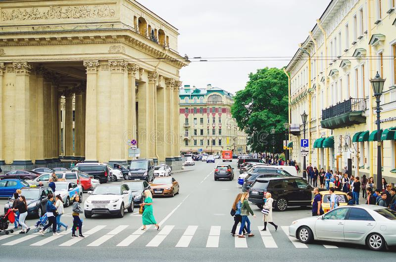 People cross the street at a pedestrian crossing. Nevsky Prospect in St. Petersburg. Saint Petersburg, RUSSIA - July 08, 2018: People cross the street at a royalty free stock photo