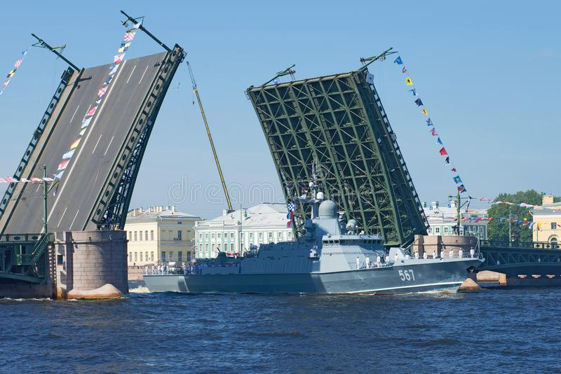 The small rocket ship `Uragan` passes the diluted Palace Bridge. SAINT-PETERSBURG, RUSSIA - JULY 29, 2018: The small rocket ship `Uragan` passes the diluted royalty free stock images