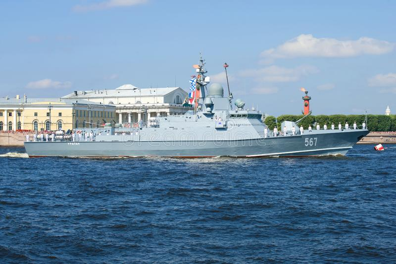The small rocket ship `Uragan` takes part in a naval parade in honor of Navy Day. SAINT-PETERSBURG, RUSSIA - JULY 29, 2018: The small rocket ship `Uragan` takes royalty free stock image