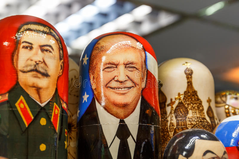 Saint Petersburg, RUSSIA - June 1, 2017: Matryoshka - Russian traditional toy with portraits of Donald Trump and Joseph Stalin royalty free stock photos