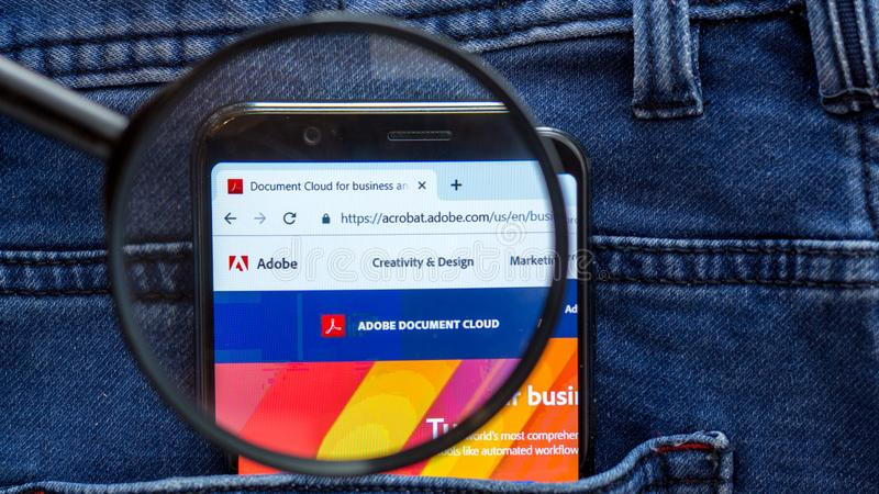 adobe website homepage. adobe logo visible on on the smartphone display royalty free stock photos