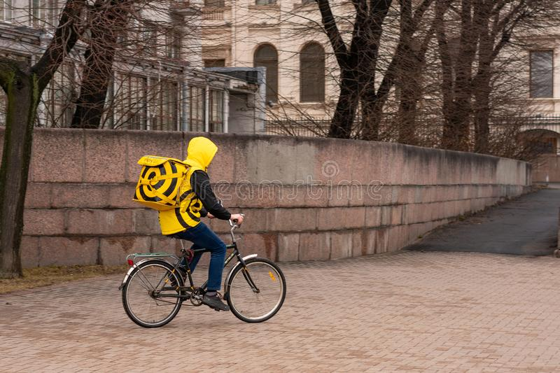 Saint Petersburg Russia March 31, 2019, food delivery by bike Yandex food.  stock images