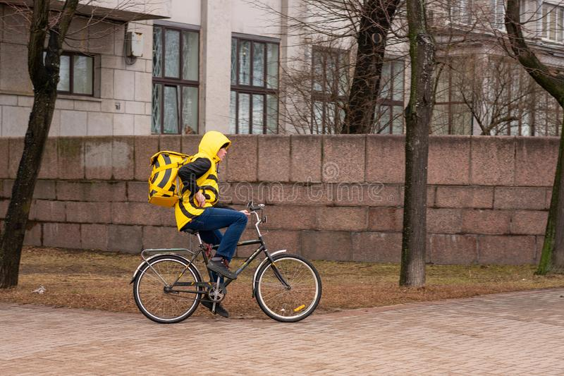 Saint Petersburg Russia March 31, 2019, food delivery by bike Yandex food.  royalty free stock photo