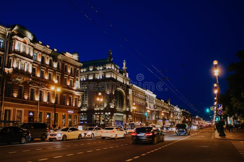 Saint Petersburg, Russia, may 2019, evening Nevsky prospect. Lights on the street lights in the city center. Traffic and road in. St. Petersburg, Russia, may stock photos