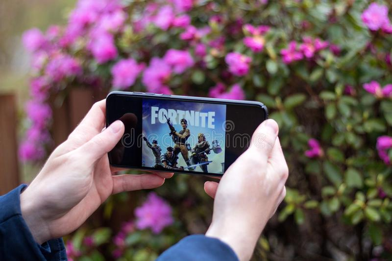 Saint Petersburg, RUSSIA -02 May, 2019: Popular fortnight game on mobile screen royalty free stock images