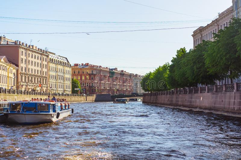 Saint Petersburg, RUSSIA - May 28, 2018: river in St. Petersburg, the channel of the Neva River delta. Tour ships swim on The Fo royalty free stock photo