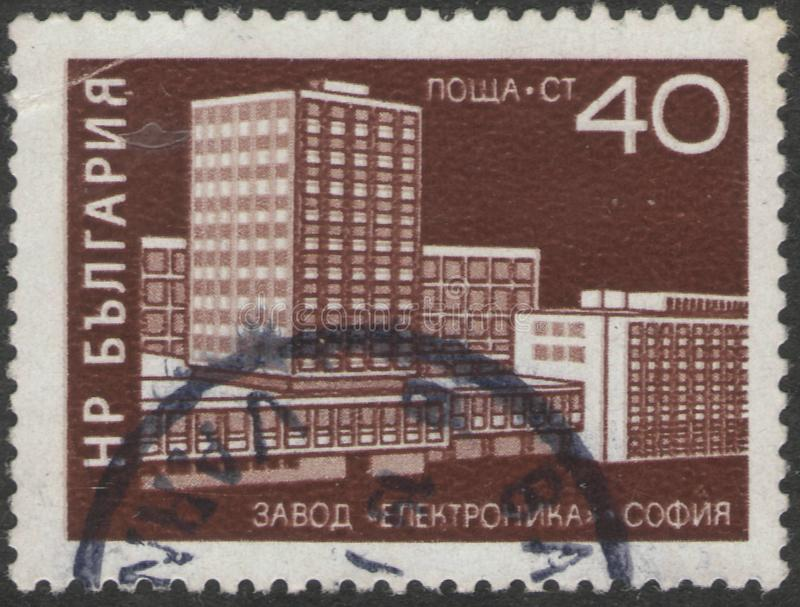 Saint Petersburg, Russia - November 27, 2018: Postage stamp printed in Bulgaria with the image of electronics factory royalty free stock image