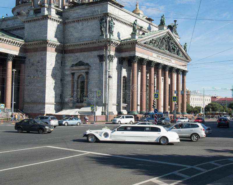 Saint Petersburg, Russia September 10, 2016: St. Wedding car decorations with passing in front of St. Isaac`s Cathedral in St. Pet royalty free stock images