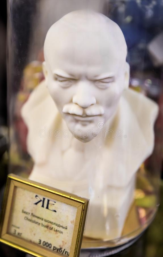 Hand-made white chocolate bust of Lenin on display at the famous grocery store Eliseevsky in Saint Petersburg, Russia stock image