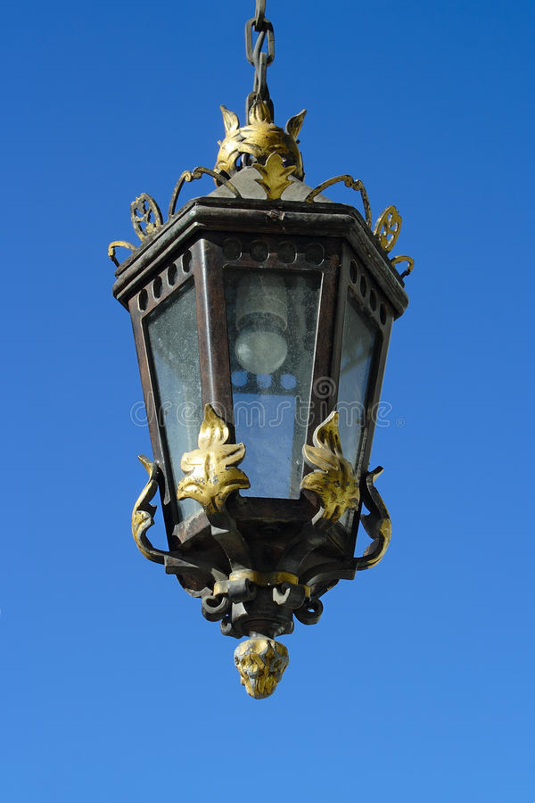 Saint-Petersburg, vintage lantern. Saint-Petersburg, vintage outboard lantern against the bright blue sky royalty free stock image