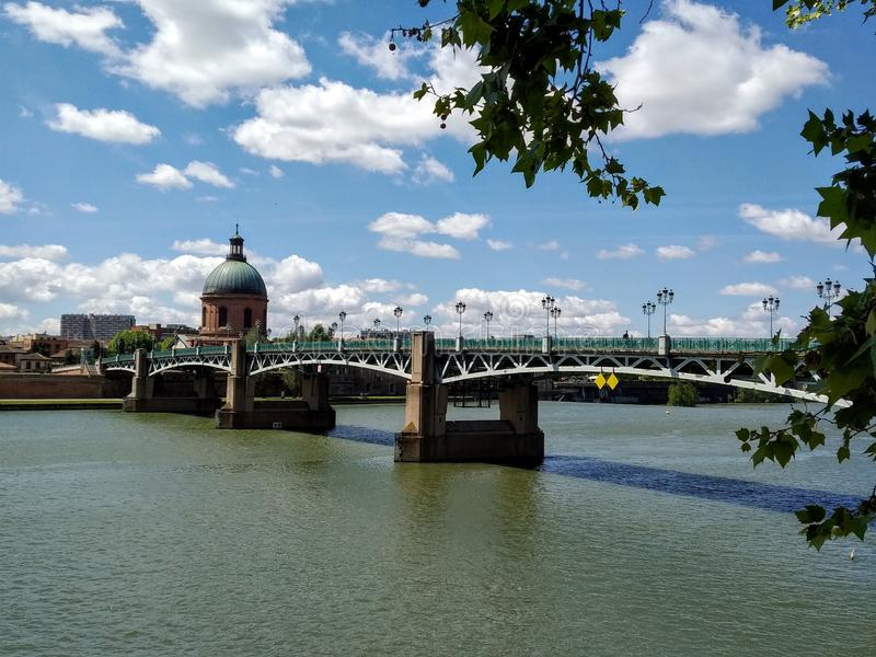 Saint Pierre Bridge in Toulouse,  France. Cloudy blue sky in the background royalty free stock photography