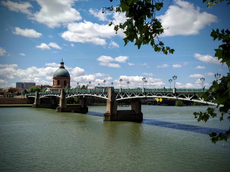 Saint Pierre Bridge in Toulouse,  France. Cloudy blue sky in the background royalty free stock images