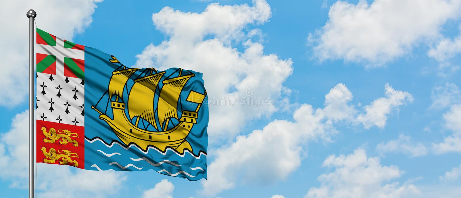 Saint Pierre And Miquelon flag waving in the wind against white cloudy blue sky. Diplomacy concept, international relations.  stock photos