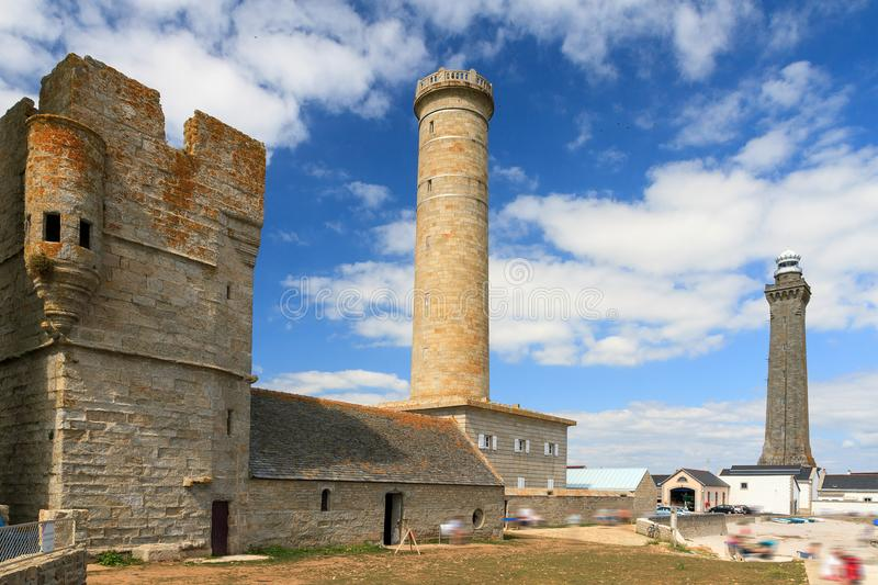 Saint-Pierre monuments. Beautiful view of the St. Peter chapel Chapelle Saint-Pierre and the Penmarc`h and the Eckmühl lighthouses in summer with a blue sky stock images